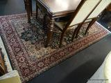 HAND MADE ORIENTAL STYLE RUG; HAS A FLORAL PATTERN IN BURGUNDY, GREEN, AND OFF-WHITE. MEASURES 8 FT