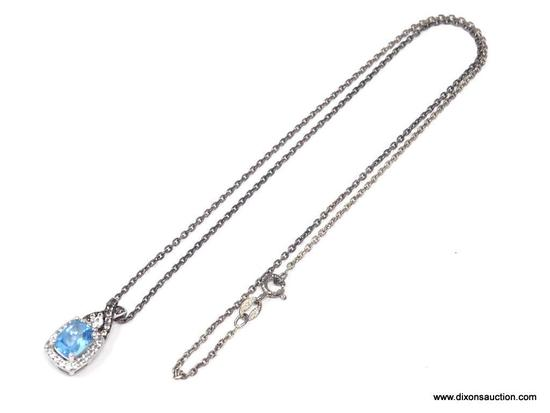 LADIES .925 STERLING SILVER 2-1/2 CT. BLUE TOPAZ PENDANT ON 18 IN. CHAIN. WEIGHS 4.6 GRAMS.
