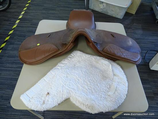 LEATHER 17 IN HORSE SADDLE; COMES WITH A FLEECE SADDLE PAD. IS CARAMEL BROWN IN COLOR.