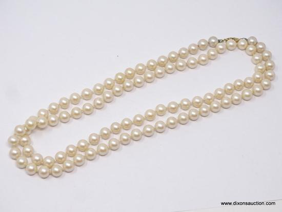 LADIES FAUX PEARL NECKLACE; 36 IN STRAND OF FAUX PEARLS WITH GOLD TONED CLASP.
