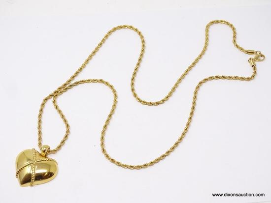 LADIES MONET GOLD TONE CHAIN WITH PENDANT; 36 IN GOLD TONE ROPE STYLE CHAIN WITH LARGE HEART SHAPED