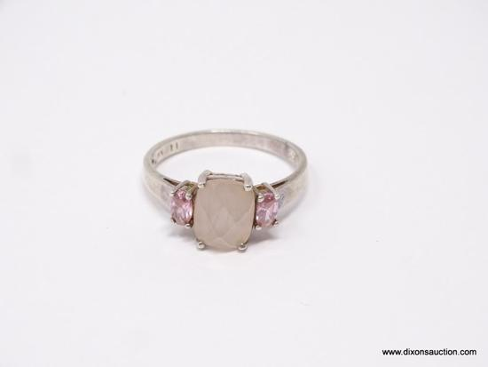 LADIES .925 STERLING SILVER RING; LARGE PINK CENTER GEMSTONE WITH PINK STONE ON EACH SIDE. SIZE 11.