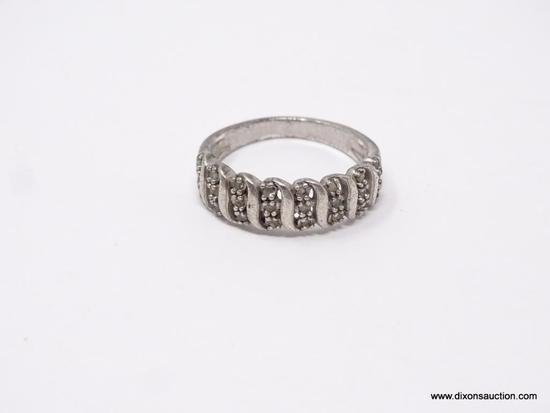 LADIES .925 STERLING SILVER RING; STERLING SILVER RING WITH 8 ROWS OF 3 CLEAR STONES IN EACH. SIZE 9