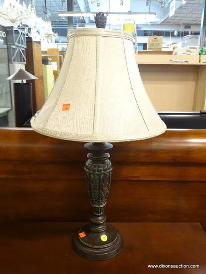 TABLE LAMP; FEATURES A DECORATIVE METAL FINIAL, BELL SHAPE TEXTURED TAUPE LAMP SHADE, LEAF DETAILS,