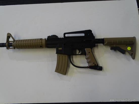 (FRONT) JT TACTICAL PAINTBALL GUN; THIS TAN AND BLACK PAINTBALL GUN INCLUDES A RAISED SIGHT RAIL,