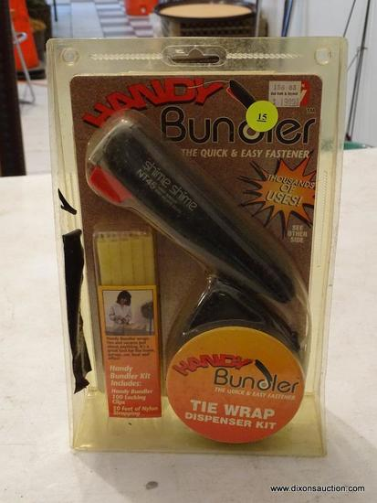 """TIE WRAP DISPENSER; """"HANDY BUNDLER"""" WITH 100 LOCKING CLIPS AND 50 FEET OF NYLON STRAPPING. BRAND NEW"""