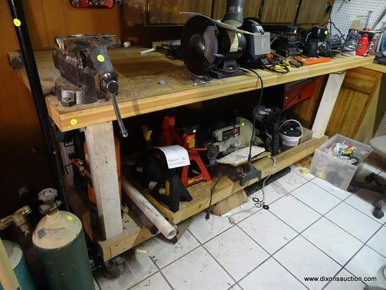 WORKBENCH; WOODEN WORKBENCH WITH LOWER SHELF AND ON CASTERS FOR EASY MOVEMENT. IS IN VERY GOOD