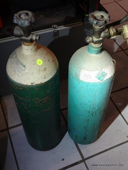 WELDING LOT; INCLUDES 2 COMPRESSED ARGON TANKS. AMOUNT OF CONTENTS ARE UNKNOWN. MEASURE 35 IN TALL.