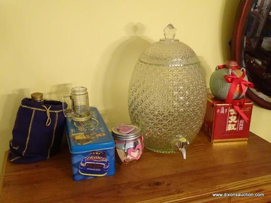 (DR) MISC.. ITEMS ON TOP OF CHEST; MISC. ITEMS INCLUDE A LIDDED GLASS TEA DISPENSER, CROWN ROYAL