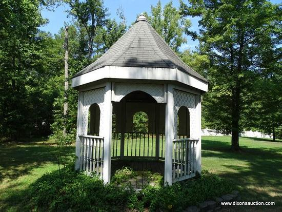 (OUT) GAZEBO; WOODEN OCTAGONAL GAZEBO. MEASURES APPROXIMATELY 11 FT 8 IN X 11 FT 8 IN X 21 FT 8 IN