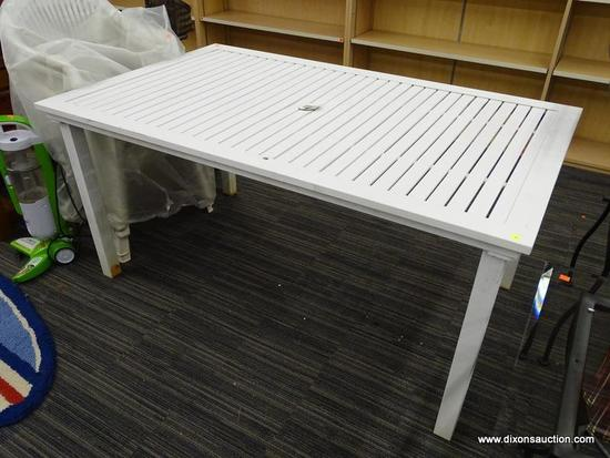 METAL PATIO TABLE; WHITE METAL RECTANGULAR PATIO TABLE WITH SLAT STYLE TOP, AND UMBRELLA HOLE. SITS