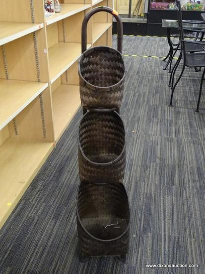 TRIPLE BASKET DECOR PIECE; THIS DARK STAINED BAMBOO BACK WITH ROUNDED HANDLE AT THE TOP HAS 3 TIERED