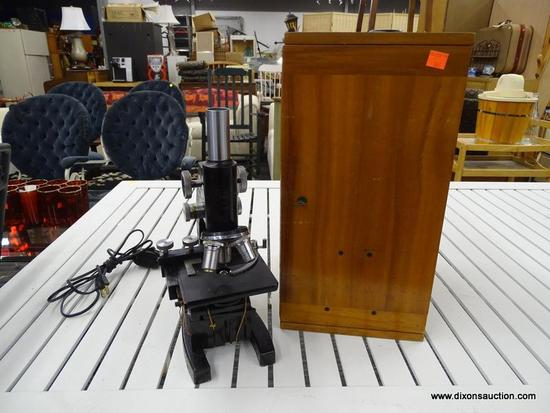 VINTAGE ELECTRIC BAUSCH & LOMB MICROSCOPE; BLACK VINTAGE MICROSCOPE MADE BY BAUSCH & LOMB. MODEL NO.
