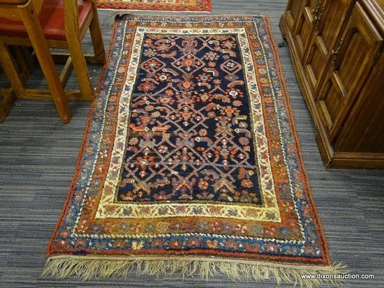 HAND KNOTTED ORIENTAL AREA RUG; BEAUTIFUL RUG IN HUES OF BLUE, RED, AND CREAM WITH A FLORAL PATTERN.