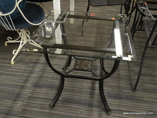 GLASS TOP SIDE TABLE; SQUARE BEVELED GLASS TOP SITTING ON A BLACK METAL BASE WITH A MARBLED-LOOK