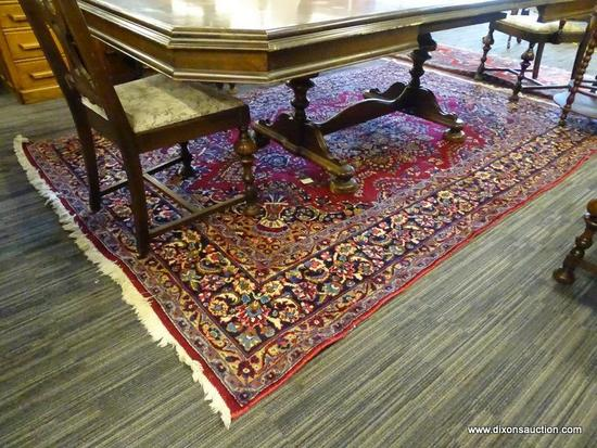 GENUINE HAND KNOTTED ORIENTAL RUG; 100% WOOL HAND KNOTTED MASHAD RUG. RED FIELD COLOR WITH A NAVY