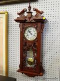 JCPENNEY WALL CLOCK; WALNUT WALL CHIME CLOCK MODEL 771-6230.