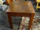 MAHOGANY SIDE TABLE; MAHOGANY TABLE WITH A CHECKBOAR WOOD PATTERN IN THE MIDDLE. STAND ON 4 CURVED
