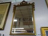 LARGE HANGING MIRROR; LARGE HANGING BEVELED GLASS MIRROR WITH A GOLD TONED WOODEN FRAME WITH RIBBON