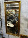 LARGE HANGING MIRROR; LARGE HANGING MIRROR WITH GOLD TONE WOODEN FRAME. MEASURES 19 IN X 41 IN.