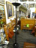 BLACK FLOOR LAMP; SIMPLE BLACK FLOOR LAMP WITH DISC AT THE TOP FOR BULB. MEASURES 74 IN TALL.