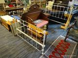 METAL BED FRAME; METAL BED FRAME PAINTED WHITE WITH BRASS AT THE FOOT AND HEADBOARD. MEASURES 82 IN