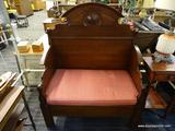 VICTORIAN STYLE BENCH; VICTORIAN STYLE MAHOGANY CAMELBACK BENCH WITH BRACKET DETAILED ARM RESTS AND