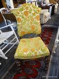 SINGLE SEAT CHAIR; SINGLE SEAT CHAIR WITH A GREEN AND ORANGE LEAF DETAILED FABRIC AROUND THE SEAT