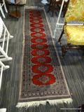 HAND KNOTTED RUG; HAND KNOTTED GRAY HALLWAY RUG WITH RED AND BLUE GEOMETRIC PATTERNING THROUGHOUT