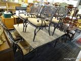 STONE PATIO SET; STONE PATIO SET WITH 8 CHAIRS. GRAY STONE TABLE TOP WITH BLACK METAL RIBBON