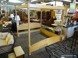 LIGHT WOODEN BED FRAME; 4 POST WOOD GRAIN BED FRAME WITH A SHELL DETAILED HEADBOARD. MEASURES 86 IN