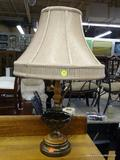 ELECTRIC TABLE LAMP; TABLE LAMP WITH A WOODEN, METAL, AND BLOWN GLASS POLE SITTING ON A METAL BASE.