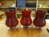 LOT OF RED STAINED GLASS VASES; 3 PIECE LOT OF LARGE RED STAINED GLASS VASES. MEASURES 8 IN TALL.