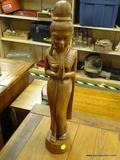 HAND CARVED WOODEN STATUE; HAND CARVED WOODEN STATUE OF A PRAYING WOMAN. MEASURES 21 IN TALL.