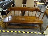 MAHOGANY BENCH; MAHOGANY BENCH WITH A ROUNDED BACK REST BEING CONNECTED TO THE BENCH SEAT BY