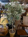 LARGE FAKE TREE IN WOVEN BASKET; LARGE FAKE TREE SITTING IN A WOVEN BASKET. MEASURES ABOUT 6.5-7