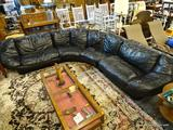 BLACK LEATHER SECTIONAL COUCH; 3 PIECE BLACK LEATHER COUCH. MEASURES 11 FT 9 LONG. SOME SEAT