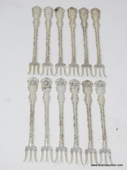 "(12) STERLING EMBOSSED & MONOGRAMMED COCKTAIL FORKS; MEASURES 5-1/2"" LONG. WEIGHS APPROX. 5.74 TROY"