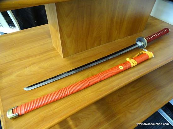 JAPANESE KATANA; SAMURAI SWORD WITH A WOODEN SHEATH COVERED IN BANDING. THE SWORD HAS A MAROON CLOTH
