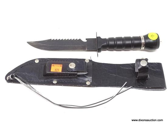 TOMAHAWK BRAND POCKET KNIFE; TOMAHAWK BRAND SABER TOOTH KNIFE WITH A PLASTIC HANDLE THAT HAS A
