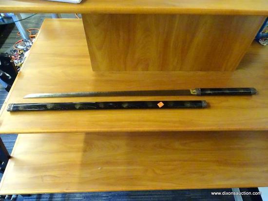 JAPANESE KATANA; JAPANESE SAMURAI SWORD WITH A BLACK WOODEN SHEATH THAT HAS BRONZE CAPS WITH DRAGONS