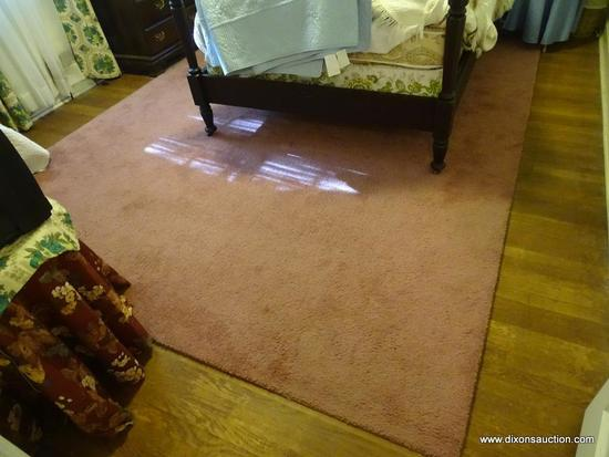 (BR) MACHINE MADE AREA RUG; PINKISH PURPLE WOOL AREA RUG. HAS ONE SOLID COLOR. MEASURES 9 FT X 11
