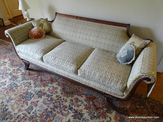 (FAM) ROLL ARM CAMELBACK SOFA; ANTIQUE CAMELBACK ROLL ARM SOFA WITH A BEIGE FLORAL FABRIC AND 4