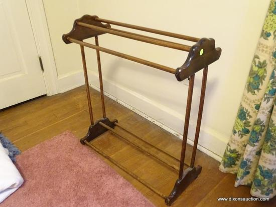 (BR) QUILT RACK; WOODEN QUILT RACK WITH BRACKET DETAILING AND 4 BALL FEET. MEASURES 2 FT .5 IN X