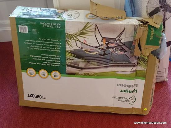 GARDEN TREASURES LOUNGER STILL IN BOX, BOX HAS BEEN TORN OPEN ON ONE SIDE, THE LOUNGER APPEARS TO BE