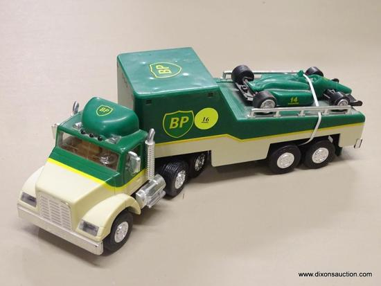 BP 18 WHEELER WITH RACER; BP 18 WHEELER GREEN AND BEIGE MODEL TRUCK WITH RACER WITH REAR AND