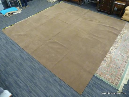 MACHINE MADE AREA RUG; LIGHT BROWN MEDIUM PILE AREA RUG. MEASURES APPROXIMATELY 14 FT X 14 FT.
