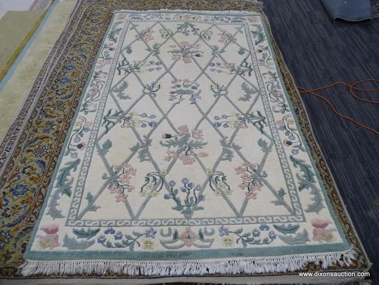 HAND KNOTTED AREA RUG; OFF-WHITE SCULPTED AREA RUG WITH PINK, YELLOW, AND BLUE FLOWERS AND PALE