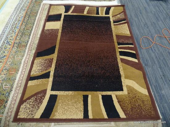 ARIANA AREA RUG; MACHINE MADE HOME DYNAMICS RUG IN BROWN, TAN, BLACK. MEASURES 4 FT 11 IN X FT 11