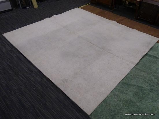 AREA RUG; OFF-WHITE MACHINE MADE AREA RUG WITH SWIRLING DESIGN. 100 % OLEFIN PILE. MEASURES